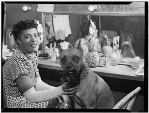 "Billie Holiday, backstage with her dog ""Mister."""